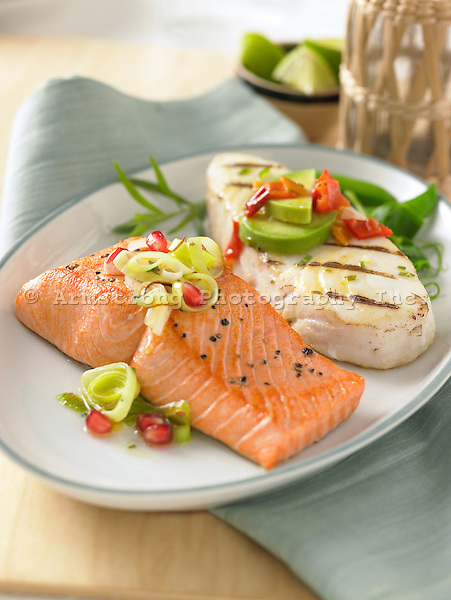 Salmon fillet with leeks, pomegranate seeds and grilled halibut steak with avocado, red pepper