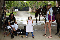 Nacho Figueras photographed in his polo gear with his wife, small daughter and a pair of horses in the stableyard of their stud farm near Buenos Aires