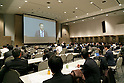 Members of the media take notes whilst Nissan Chairman and CEO Carlos Ghosn speaks during an extraordinary stockholders meeting at Makuhari Messe on December 14, 2016, in Makuhari, Japan. Mitsubishi Motors approved the implementation of a new management structure based on their alliance with Renault-Nissan. Ghosn, who is now also Chairman of MMC, also attended the meeting. Nissan is Mitsubishi Motors largest shareholder holding 34%. (Photo by Rodrigo Reyes Marin/AFLO)