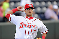 Center fielder Jesus Loya (17) of the Greenville Drive before a game against the Lexington Legends on Monday, August 16, 2013, at Fluor Field at the West End in Greenville, South Carolina. Lexington won, 5-1. (Tom Priddy/Four Seam Images)