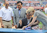 Hideki Matsui,<br /> JULY 28, 2013 - MLB :<br /> Hideki Matsui signs his reitement papers with Yankees assistant general manager Jean Afterman as his father Masao and Yankees general manager Brian Cashman look on during his official retirement ceremony before the Major League Baseball game against the Tampa Bay Rays at Yankee Stadium in The Bronx, New York, United States. (Photo by AFLO)