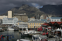 JUNE 8, 2005, CAPE TOWN, SOUTH AFRICA: Table Mountain towers over the waterfront and downtown of Cape Town, South Africa.  Cape Town is famed for its breathtaking views, wine production and seafood. Photo by Matt May