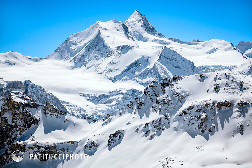 The Bishorn, 4153 meters, with the Weisshorn in the background in winter. Switzerland