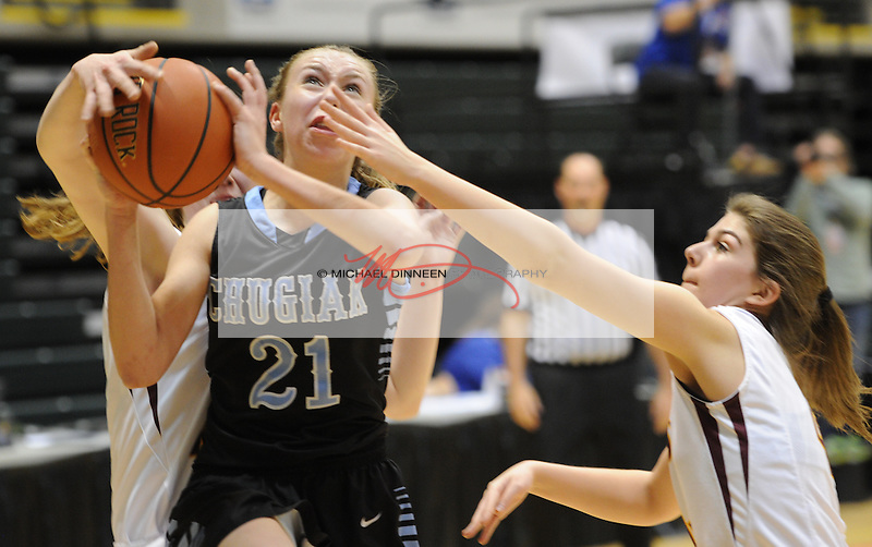Chugiak's Randi McMullen drives through Ketchikan defenders in the state basketball tournament.   Photo for the Star by  Michael Dinneen