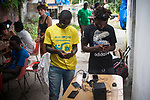 Two African migrants attend their smartphones in Lakaxita. Irun (Basque Country). August 28, 2018. Lakaxita is a self-managed socio-cultural space located in an occupied house, where volunteers have created a hosting network for migrants in transit who have already completed the 5-day period that can remain in public resources. This group of volunteers is avoiding a serious humanitarian problem Irún, the Basque municipality on the border with Hendaye. As the number of migrants arriving on the coasts of southern Spain incresead, more and more migrants are heading north to the border city of Irun. (Gari Garaialde / Bostok Photo)
