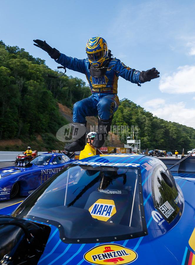 Jun 18, 2017; Bristol, TN, USA; NHRA funny car driver Ron Capps celebrates after winning the Thunder Valley Nationals at Bristol Dragway. Mandatory Credit: Mark J. Rebilas-USA TODAY Sports