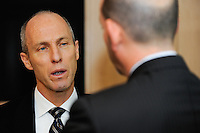 USA National Team Head Coach Bob Bradley talks with Major League Soccer Commissioner Don Garber during a meeting of members of the USA Bid Committee for the FIFA World Cup in New York, NY on December 15, 2009.