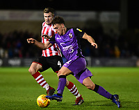 Lincoln City's Michael O'Connor battles with Port Vale's Luke Hannant<br /> <br /> Photographer Andrew Vaughan/CameraSport<br /> <br /> The EFL Sky Bet League Two - Lincoln City v Port Vale - Tuesday 1st January 2019 - Sincil Bank - Lincoln<br /> <br /> World Copyright &copy; 2019 CameraSport. All rights reserved. 43 Linden Ave. Countesthorpe. Leicester. England. LE8 5PG - Tel: +44 (0) 116 277 4147 - admin@camerasport.com - www.camerasport.com