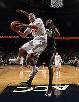 Virginia guard London Perrantes (23) shoots next to Wake Forest forward Travis McKie (30) during the game Wednesday Jan. 08, 2014 in Charlottesville, Va. Virginia defeated Wake Forest 74-51.