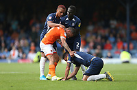 Blackpool's Jay Spearing tries to pull up Southend United's Mark Milligan but is stopped by Layton Ndukwu and Elvis Bwomono<br /> <br /> Photographer Rob Newell/CameraSport<br /> <br /> The EFL Sky Bet Championship - Southend United v Blackpool - Saturday 10th August 2019 - Roots Hall - Southend<br /> <br /> World Copyright © 2019 CameraSport. All rights reserved. 43 Linden Ave. Countesthorpe. Leicester. England. LE8 5PG - Tel: +44 (0) 116 277 4147 - admin@camerasport.com - www.camerasport.com