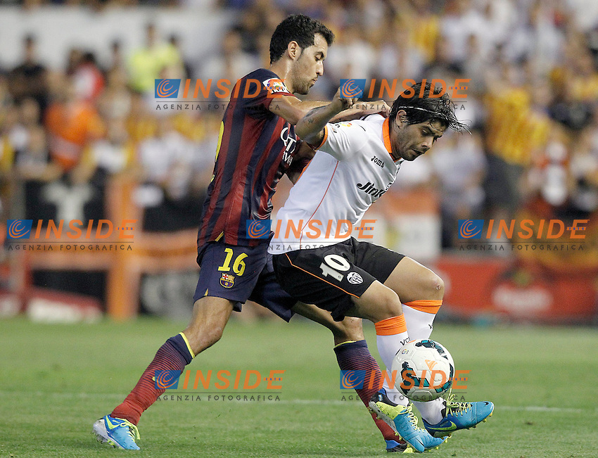 Valencia's Ever Banega (r) and FC Barcelona's Sergio Busquets during La Liga match.September 1,2013. (ALTERPHOTOS/Acero) <br /> Football Calcio 2013/2014<br /> La Liga Spagna<br /> Foto Alterphotos / Insidefoto <br /> ITALY ONLY