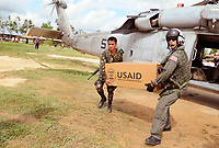 Working together a soldier from the Philippine Army and Petty Officer 2nd Class Anthony Chavez move relief supplies to a school on the Island of Panay on July 1, 2008.  A member of Helicopter Anti-Submarine Squadron 4, Chavez has been flying humanitarian missions into the island in the wake of Typhoon Fengshen.  At the request of the government of the Republic of the Philippines, the USS Ronald Reagan is off the coast of Panay Island providing humanitarian assistance and disaster relief.  The Ronald Reagan is operating in the 7th Fleet area of responsibility to support maritime security operations.  DoD photo by Senior Chief Spike Call, U.S. Navy.  (Released)