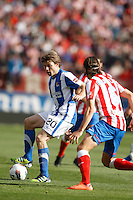 02.05.2012 SPAIN -  La Liga matchday 20th  match played between Atletico de Madrid vs Real Sociedadl (1-1) at Vicente Calderon stadium. The picture show Asier Illarramendi Andonegi (Midfielder of Real Sociedad) and Filipe Luis Karsmirski (Brazilian defender of At. Madrid)