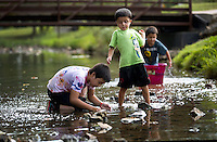 NWA Democrat-Gazette/JASON IVESTER <br /> James Coursey (from left), 10, Levi Solis (cq), 6, and Carlos Solis, 9, play in the creek on Friday, Sept. 4, 2015, at Horsebarn Trailhead in Rogers. The boys along with their brothers and respective mothers were out on a play date at the park.