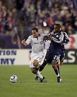 Toronto FC midfielder Nick LaBrocca (21) and New England Revolution midfielder Joseph Niouky (23) battle in midfield. The New England Revolution defeated Toronto FC, 4-1, at Gillette Stadium on April 10, 2010.