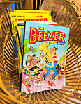 1980s children's cartoon comic annuals the Beezer annual book 1986, inside antiques centre, Marlesford Mill, Suffolk, England, UK