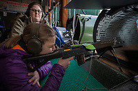 "Switzerland. Canton Ticino. Cureglia is a municipality in the district of Lugano. ""Tiratori del Gaggio"" society. Shooting range. Young shooters' course. The courses, whose organisation is delegated by the Federal Department of Defence, Civil Protection and Sport to the various local shooting societies, are open to young swiss people, boys and girls, from 15 to 20 years old. Girls and boys learn how to handle and fire with the assault rifle SG 550, also called Fass 90, used by the Swiss Army. Giulia is 15 years old. She shoots her Fass 90 loaded with bullets on targets distant 300 meters under the supervision of her instructor, Sonia Castelli (L). Acoustic foam used inside a pipe in to dampen and absorb the gun shot's sound. The SG 550 is an assault rifle manufactured by Swiss Arms AG (formerly Schweizerische Industrie Gesellschaft) of Neuhausen, Switzerland. ""SG"" is an abbreviation for Sturmgewehr, or ""assault rifle"". The rifle is known as the Fass 90 or Stgw 90. An assault rifle is a selective-fire rifle that uses an intermediate cartridge and a detachable magazine. 9.02.2019 © 2019 Didier Ruef"