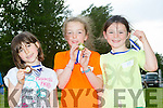2nd place Lucy Mulgrew from Blenerville Ballyard, 1st Place Laura Falvey from St Brendan's Ardfert and 3rd place Emily Flynn from Tralee Harrier's at the Tralee Harriers open sports day on Thursday