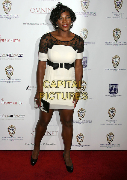 "SERENA WILLIAMS.60th Anniversary of Israel ""From Vision to Reality"" held at Paramount Studios, Los Angeles, California, USA..September 18th, 2008.full length white black lace dress clutch bag belt sheer shoes platform.CAP/ADM/MJ.©Michael Jade/AdMedia/Capital Pictures."