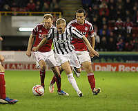 Gary Teale being tackled by Stephen Hughes (left) and Gavin Rae in the Aberdeen v St Mirren Scottish Communities League Cup match played at Pittodrie Stadium, Aberdeen on 30.10.12.