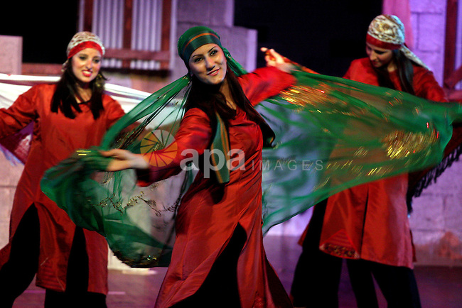 A Palestinian dancers perform a traditional dancing at the cultural palace in the West Bank city of Ramallah on June 27, 2009. Photo by Issam Rimawi