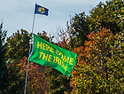 "Oct 11, 2014; A flag with the slogan ""Here Come The Irish"" flies above a tailgater before the North Carolina game. (Photo by Matt Cashore)"