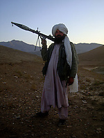 A commander from the Wardak Mobile Patrol Unit armed with an RPG [rocket propelled grenade] out on patrol in the mountains of wardak