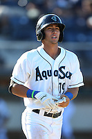 Austin Cousino #19 of the Everett AquaSox runs to first base during a game against the Boise Hawks at Everett Memorial Stadium on July 25, 2014 in Everett, Washington. Everett defeated Boise, 3-1. (Larry Goren/Four Seam Images)