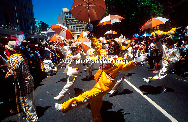 "dippcoo00035 .People. Coons. CAPE TOWN, SOUTH AFRICA - JANUARY 2: Unidentified participants during the yearly ""Coon Carnival"" on January 2, 2003 in Cape Town, South Africa. The carnival performers are primarily mixed-race, or colored people and the carnival began in the early 19th century when slave bands played friendly competition during the annual Jan. 2 slave holiday. The parade has become a popular tourist attraction and the colorful floats are competing at a local stadium for days for the best costumes and performances..©Per-Anders Pettersson/ iAfrika Photos.."