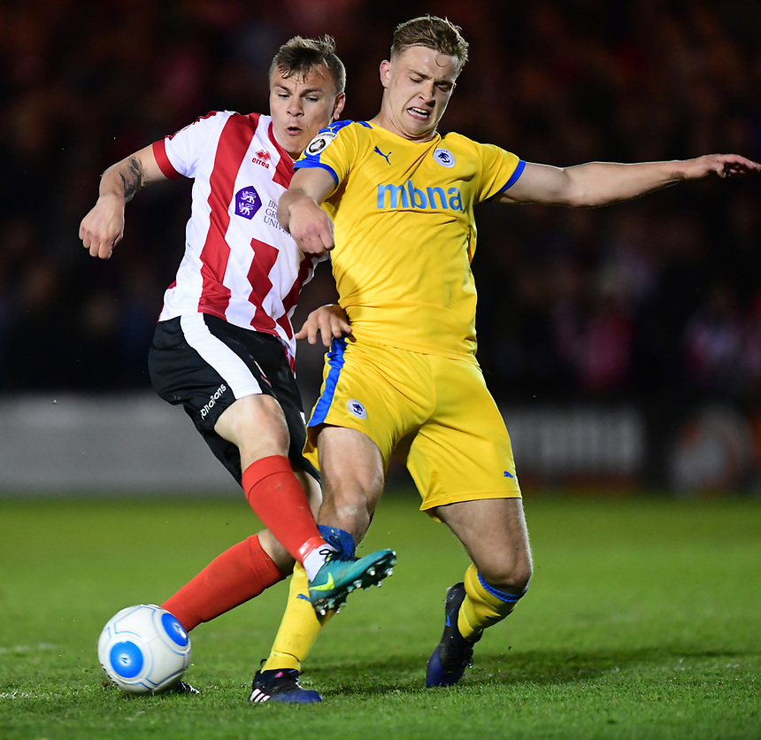 Lincoln City's Harry Anderson is tackled by Chester's Sam Hughes<br /> <br /> Photographer Chris Vaughan/CameraSport<br /> <br /> Vanarama National League - Lincoln City v Chester - Tuesday 11th April 2017 - Sincil Bank - Lincoln<br /> <br /> World Copyright &copy; 2017 CameraSport. All rights reserved. 43 Linden Ave. Countesthorpe. Leicester. England. LE8 5PG - Tel: +44 (0) 116 277 4147 - admin@camerasport.com - www.camerasport.com