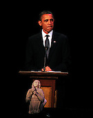 "United States President Barack Obama makes remarks at ""The Washington National Cathedral's A Call to Compassion"" Concert for Hope to commemorate the 10th anniversary of the terrorist attacks in New York, New York and Washington, D.C. on Sunday, September 11, 2011.  The angel in front of the President fell from one of the spires of the National Cathedral during the earthquake..Credit: Ron Sachs / Pool via CNP"
