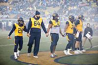 BERKELEY, CA - November 26, 2016: Cal's (26) Bug Rivera, (64) Steven Moore, (9) James Looney, (31) Raymond Davison and (7) Davis Webb for the coin toss. Cal played UCLA at California Memorial Stadium.