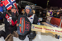 Joar Leifseth Ulsom recieves his Dodge Ram Winner's truck from Chuck Talskey of Anchorage Chrysler Dodge at the finish line in Nome, Alaska early on Wednesday morning March 14th as he wins the 46th running of the 2018 Iditarod Sled Dog Race.  He finished in 9 days 12 hours 00 minutes and 00 seconds<br /> <br /> Photo by Jeff Schultz/SchultzPhoto.com  (C) 2018  ALL RIGHTS RESERVED