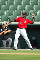 Kannapolis Intimidators first baseman Keon Barnum (35) catches a pop fly in foul territory against the Hickory Crawdads at CMC-Northeast Stadium on July 28, 2013 in Kannapolis, North Carolina.  The Crawdads defeated the Intimidators 6-1.  (Brian Westerholt/Four Seam Images)