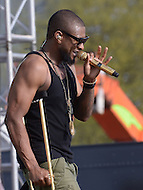 Washington, DC - April 18, 2015: Grammy Award winning artist Usher performs at the annual Earth Day concert on the National Mall in the District of Columbia April 18, 2015. Usher entertained an audience of more than 200,000 despite having a brace on his foot.  (Photo by Don Baxter/Media Images International)