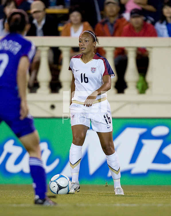 Angela Hucles holds the ball. USA defeated Japan 4-1 at Spartan Stadium in San Jose, CA on July 28, 2007.