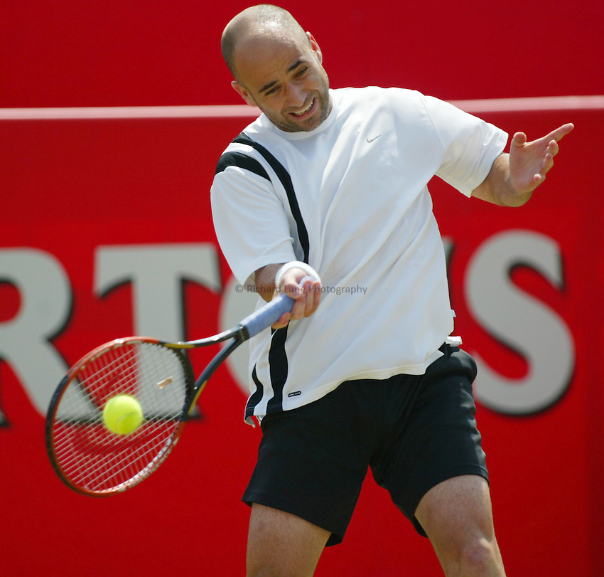 Photograph: Scott Heavey..Day 6 of the Stella Artois Championship at the Queens Club. 14/06/2003..Andre Agassi