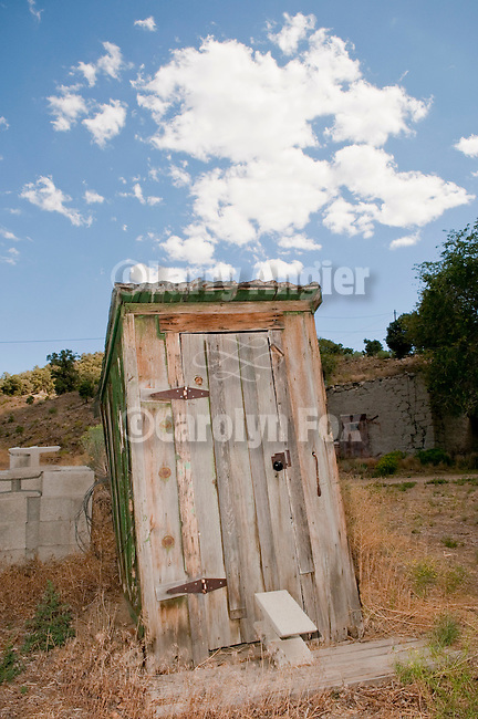 Wooden outhouse with clouds