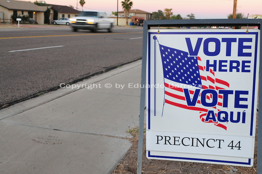 "Apache Junction, Arizona. November 6, 2012 - A bilingual ""Vote Here"" sign on a sidewalk next to Precinct 44 at a Moose Lodge chapter building in Apache Junction, Arizona directs voters to a poll place for the Nov. 6 election. Photo by Eduardo Barraza © 2012"