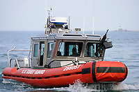 A U. S. Coast Guard boat pulls into the lock connecting the Chicago River to Lake Michigan in Chicago, Illinois on August 5, 2008.