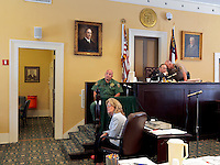 Judge Prior talks with a sheriff while presiding at Greene County Courthouse which was built in 1849 and later extended.