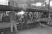 (021303-SWR03.jpg) New York, NY -- Circa 1988 - Workers repair, restore, and do routine maitenance on subway cars at the  New York City's Transity Authority 211th Street Lay Ups.