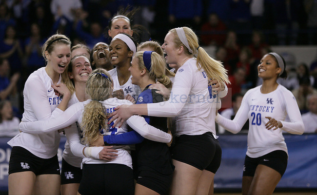 The team celebrates their victory over Ohio State after the University of Kentucky vs Ohio State University in the second round of the NCAA Volleyball Tournament in Lexington, Ky., on, 12/1/2012. Photo by Jared Glover | Staff