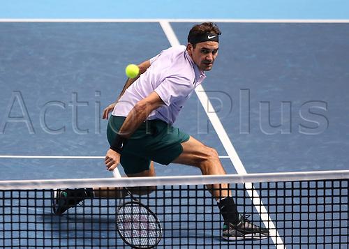 14th November 2017, O2 Arena, London, England; Nitto ATP Tennis Finals; Roger Federer (SWZ) return backhand at the net to Alexander Zverev Jr (GER)