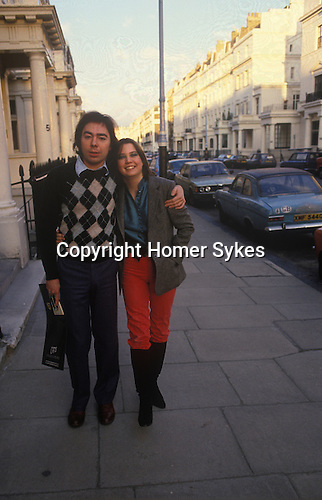 Andrew Lloyd Webber and is first wide Sarah Hughill outside their Chelsea London home. Andrew is holding promo material for his new musical Cats. 1980.