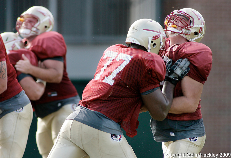 TALLAHASSEE, FL. 8/18/09-FSU-OFFENSIVE LINE 0818 CH01-Florida State's Zebrie Sanders, left, collides with Jonathan Johnson during practice Tuesday in Tallahassee...COLIN HACKLEY PHOTO