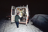 Paramedic ambulance crew putting a casualty in a wheelchair into the back of the ambulance. This image may only be used to portray the subject in a positive manner..©shoutpictures.com..john@shoutpictures.com