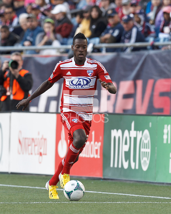 FC Dallas substitute midfielder Je-Vaughn Watson (27) dribbles down the wing.  In a Major League Soccer (MLS) match, FC Dallas (red) defeated the New England Revolution (blue), 1-0, at Gillette Stadium on March 30, 2013.