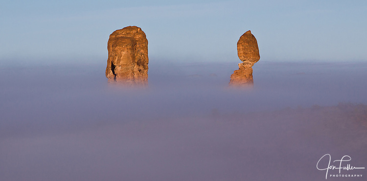 Balanced Rock appears above a winter fog in Arches National Park near Moab, Utah.