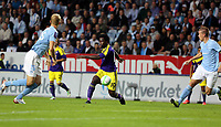 Thursday 08 August 2013<br /> Pictured: Wilfried Bony of Swansea (C) passing the ball past Pawel Cibicki (L) of Malmo.<br /> Re: Malmo FF v Swansea City FC, UEFA Europa League 3rd Qualifying Round, Second Leg, at the Swedbank Stadium, Malmo, Sweden.